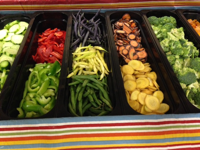 Riverview School District's Salad bar includes local cucumbers, sweet peppers, beans and purple carrots.