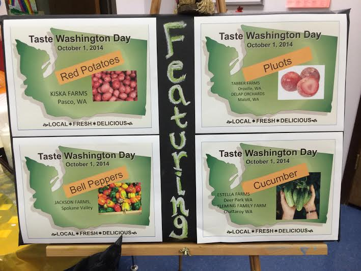 Taste Washington Day signs for red potatoes, pluots, bell peppers and cucumber highlighted the farms that grew the food.