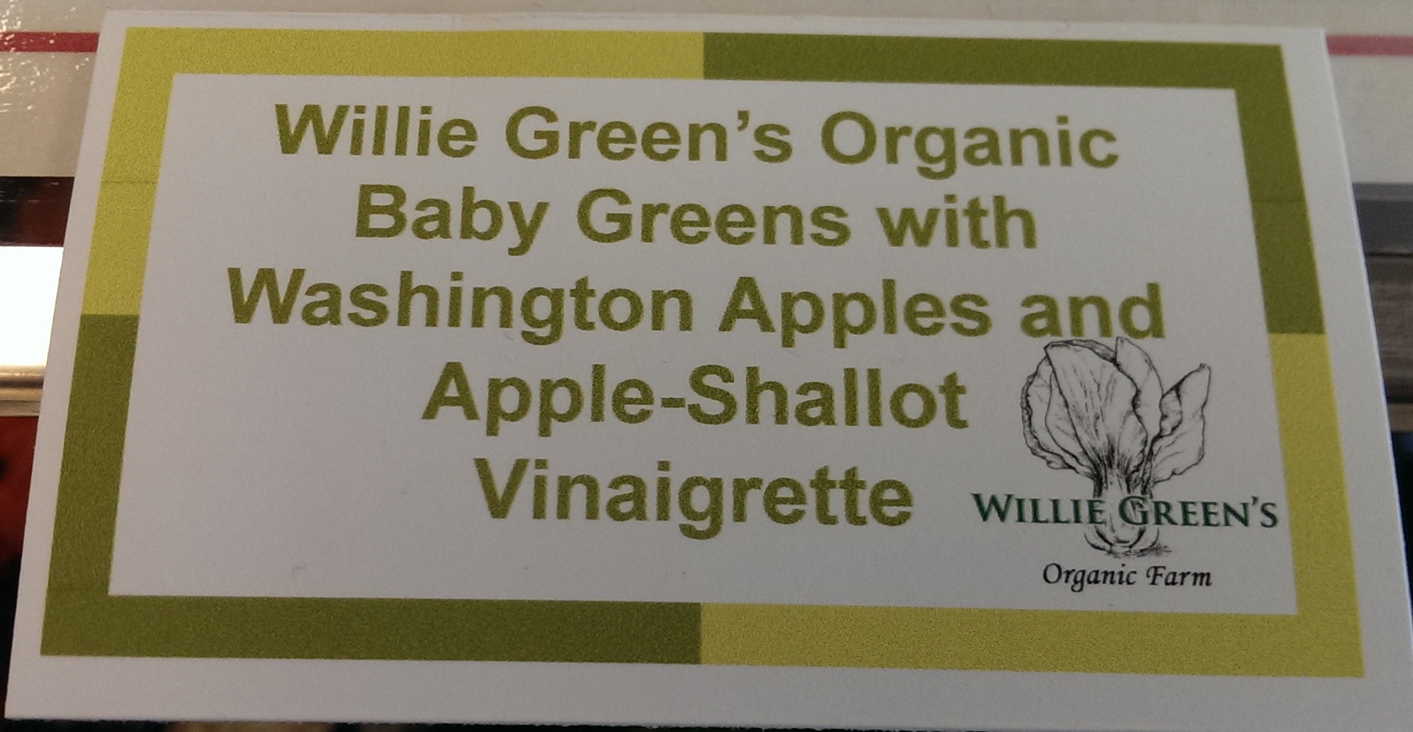 Sign from Monroe Cafeteria with words: Willie Green's Organic Baby Greens with Washington Apples and Apple-Shallot Vinaigrette
